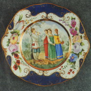 Wall Plate. Young Ladies and a young Sheferd. Over Glasour Painting on Porcelain. D 27 cm